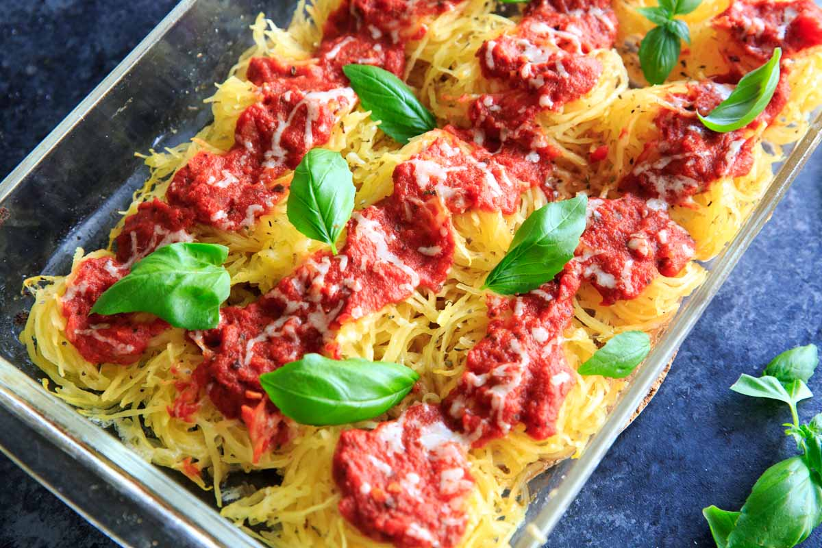 Spaghetti Squash Nests garnished with fresh basil are the perfect dinner appetizer for your guests. Customizable and delicious!