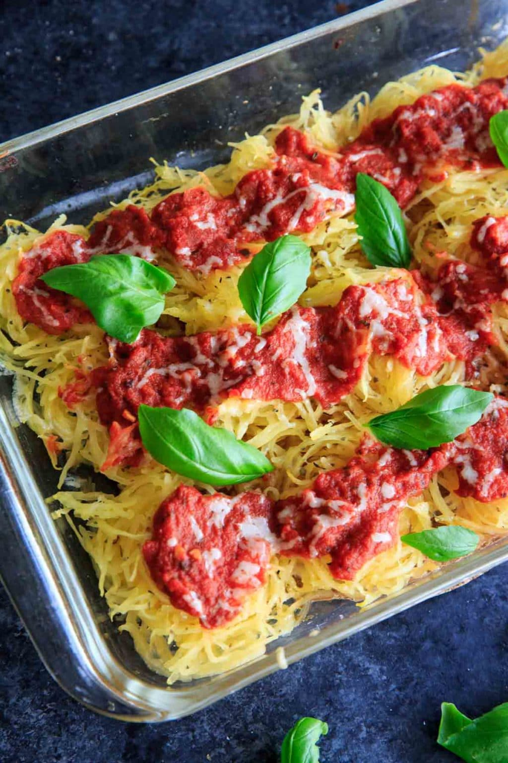 Spaghetti Squash Nests garnished with fresh basil are the perfect dinner appetizer for your guests. Customizable and delicious! Vegan-friendly and gluten-free.