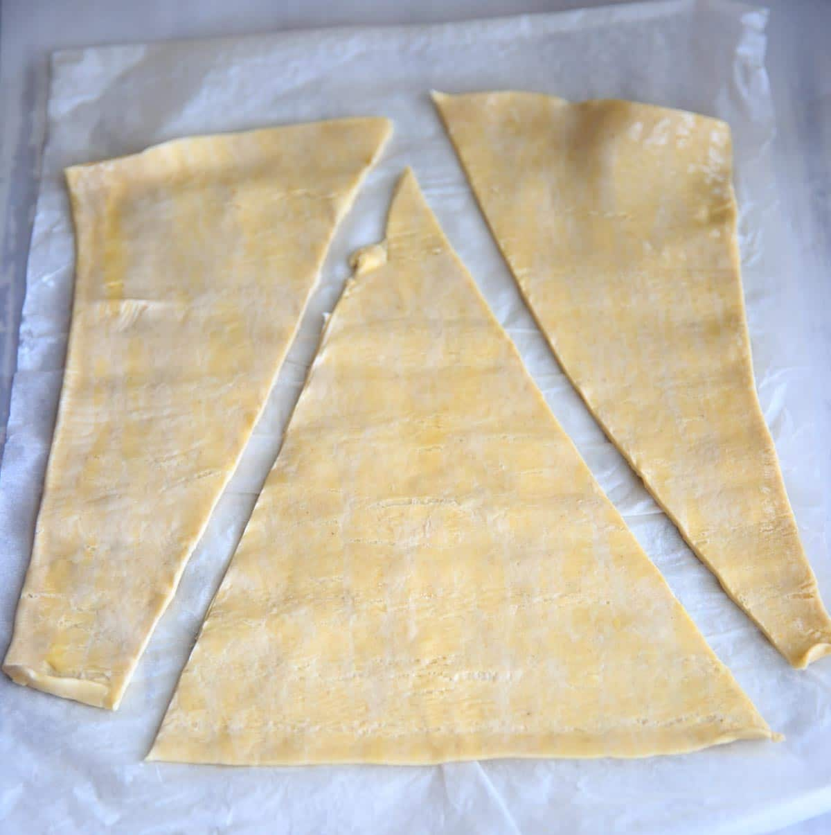Cutting the puff pastry into a triangle