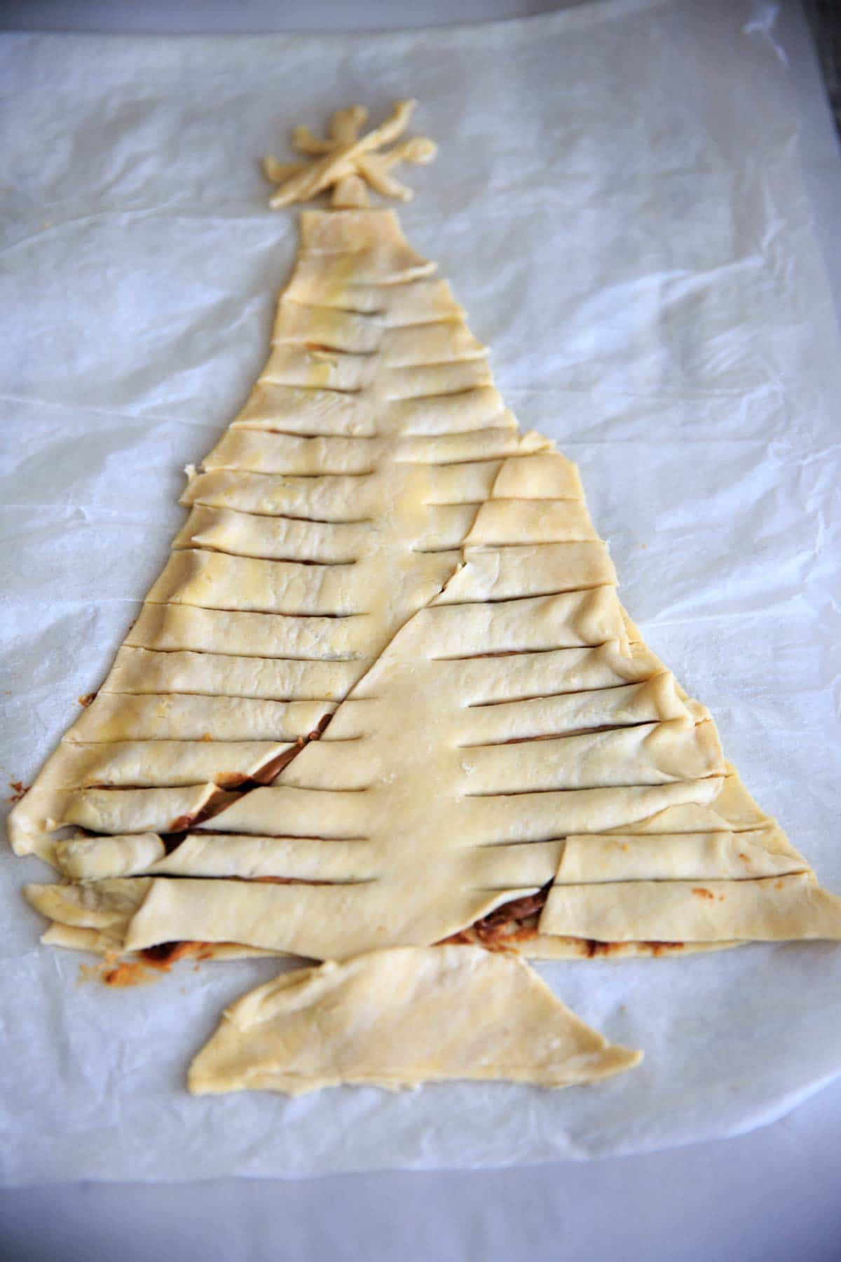 Cover with another layer of puff pastry and cut branches into pastry.