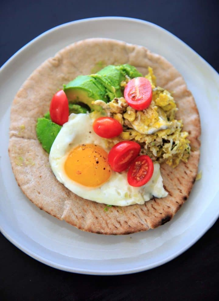 A quick breakfast idea: avocado, tomato, and egg on a pita wrap.