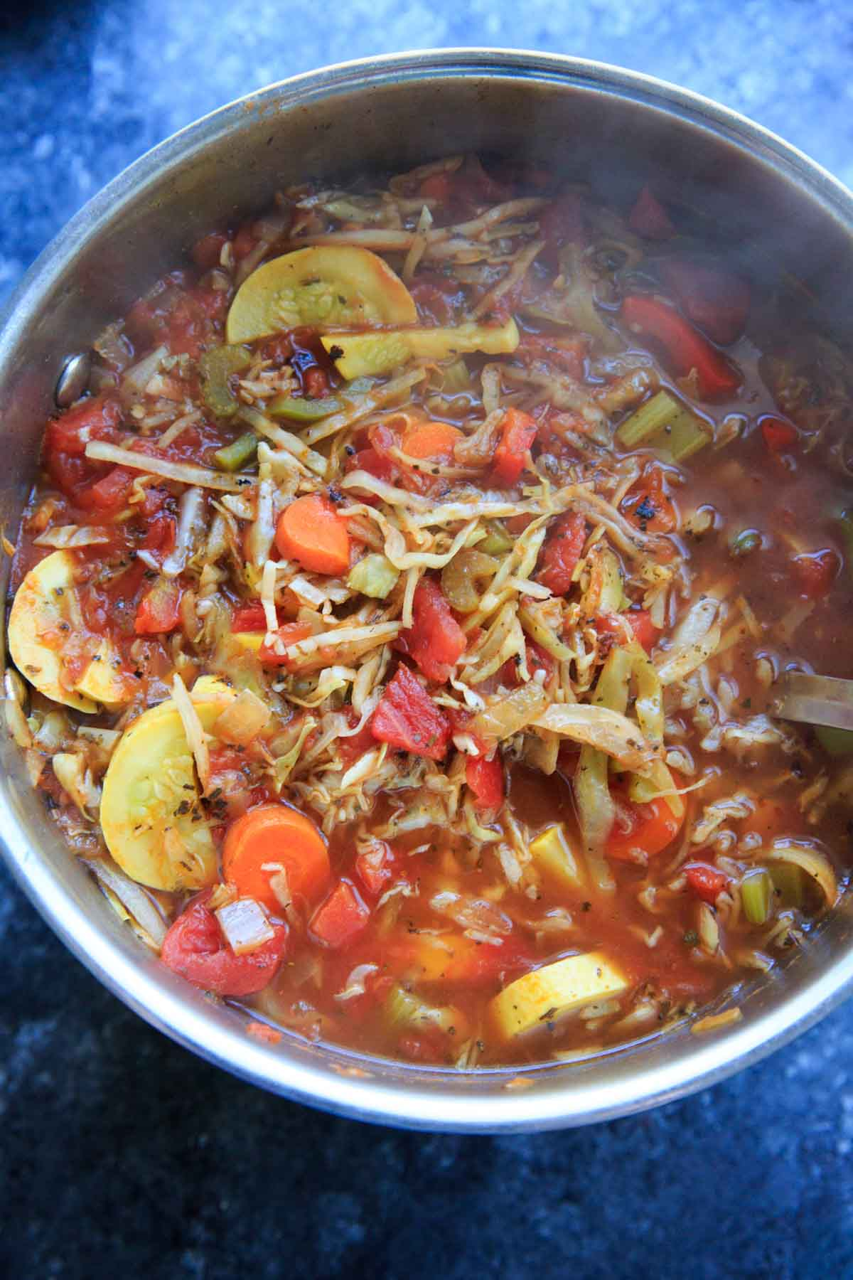 detox cabbage soup with tomatoes and squash in pot