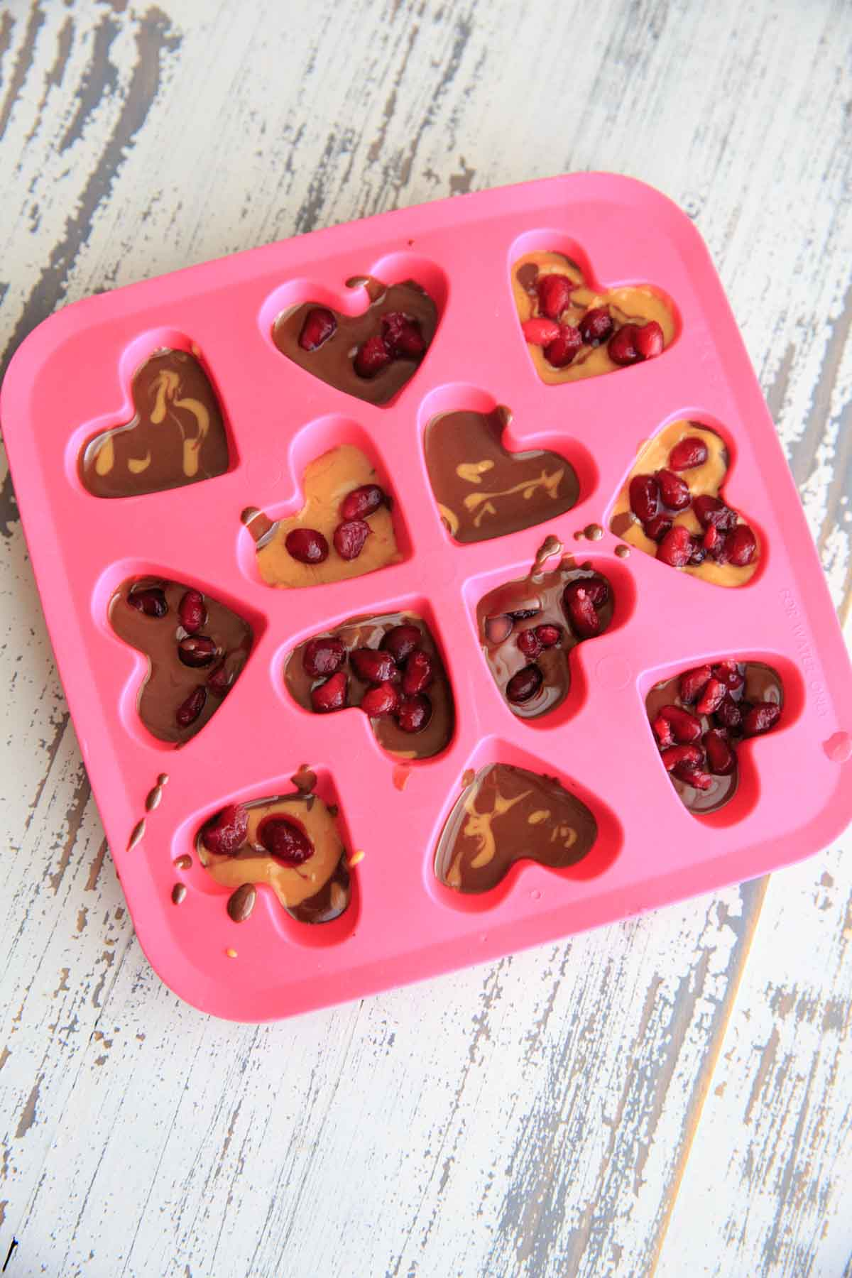 Chocolate Pomegranate Candy Recipe - melted chocolate peanut butter with pomegranate seeds