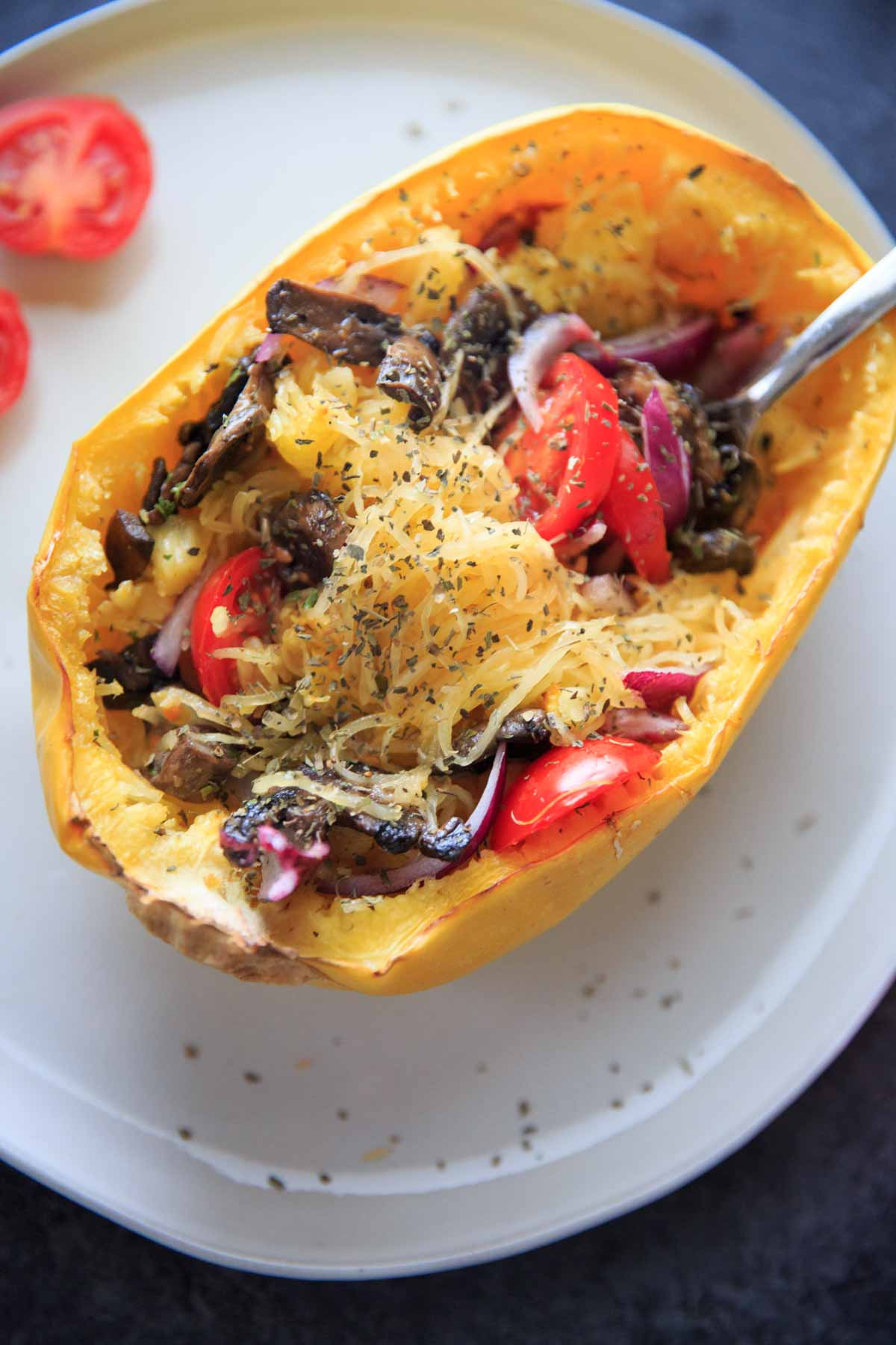 Spaghetti Squash with Mushrooms Recipe - still in squash shell with herbs