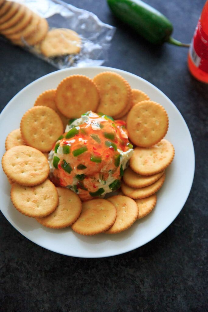 Sweet Chili Cream Cheese Dip - a super easy, 4 ingredient appetizer that is perfect for a party snack or sharable dip. Sweet and spicy and delicious!
