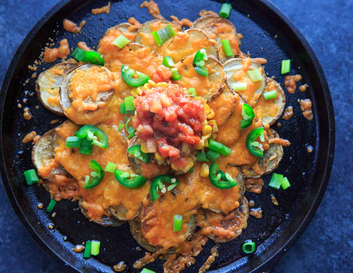 Irish Pub Potato Nachos Recipe - potato slices with cheddar cheese, jalapeno, green onion, corn salsa and tomato salsa (horizontal)
