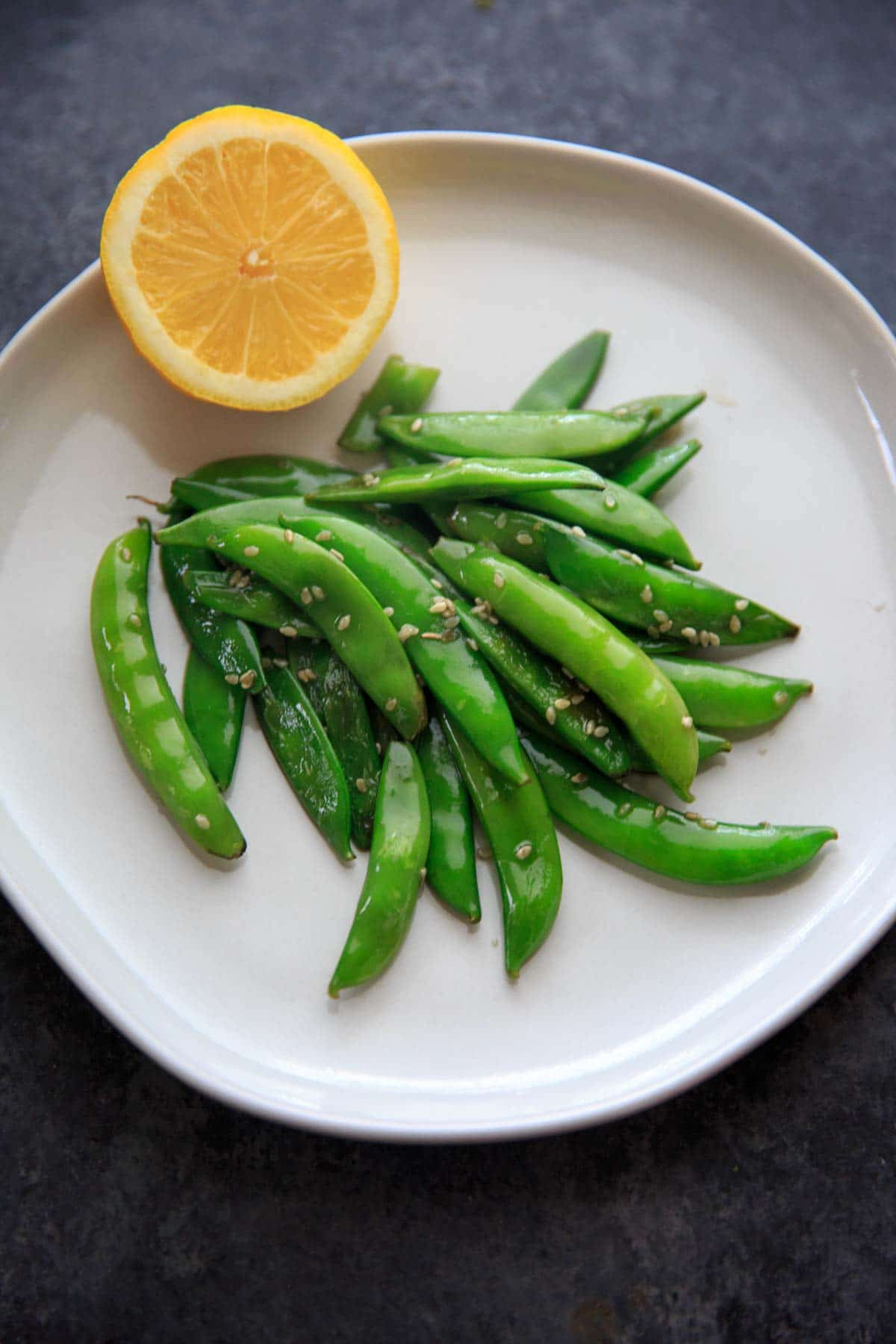 A citrusy and tasty vegetable side dish - Stir-fried Lemon Sesame Sugar Snap Peas! Eat as is for a side, add to pasta or salads.
