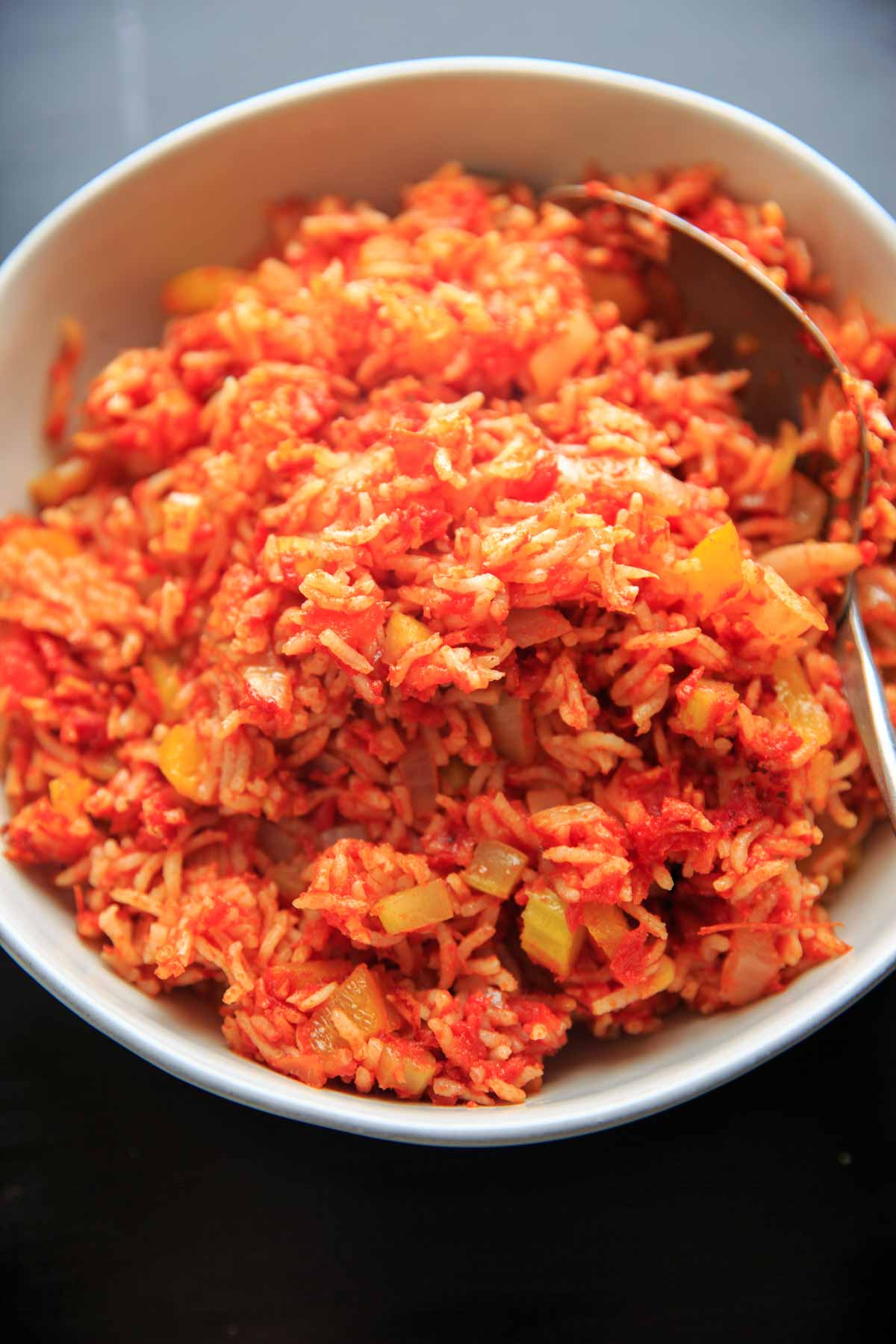 Nana's Spanish Rice recipe - a super easy, one pan / one pot side dish that takes only minutes to throw together. No need to pre-cook the rice! Naturally vegan and gluten-free.