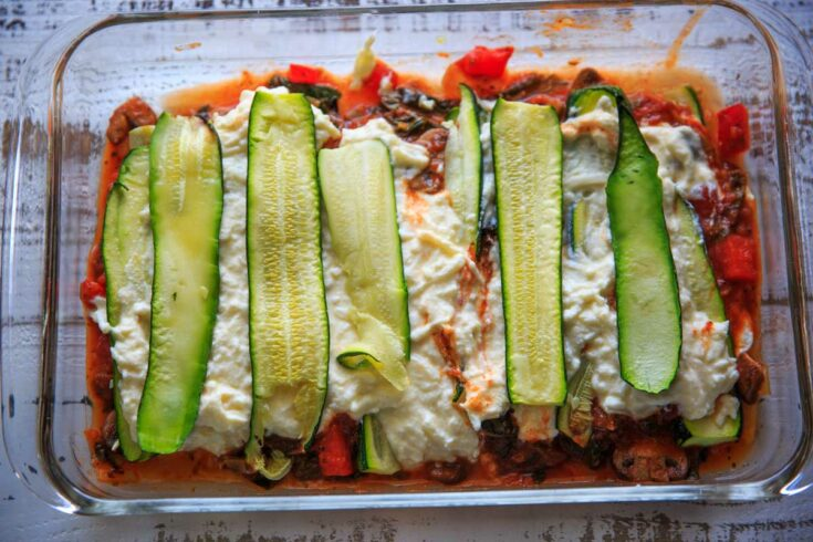 Layering the zucchini noodles on the lasagna