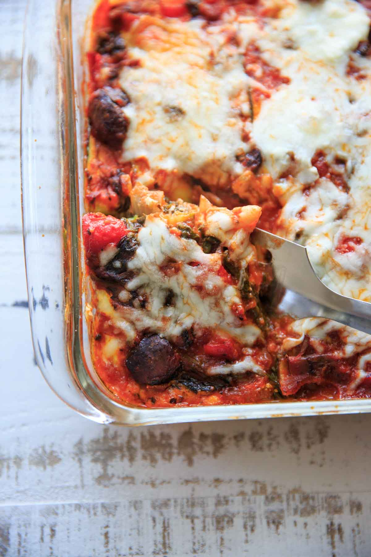 Gluten-free zucchini noodle vegetable lasagna. A way to enjoy lasagna without the pasta! Whether you're trying to cut back on pasta or simply trying to sneak more veggies in your food, this is a way to pack your meatless dinner full of nutrients.