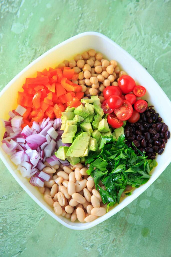 Three Bean Salad with avocado, vegetables and herbs - before mixing together