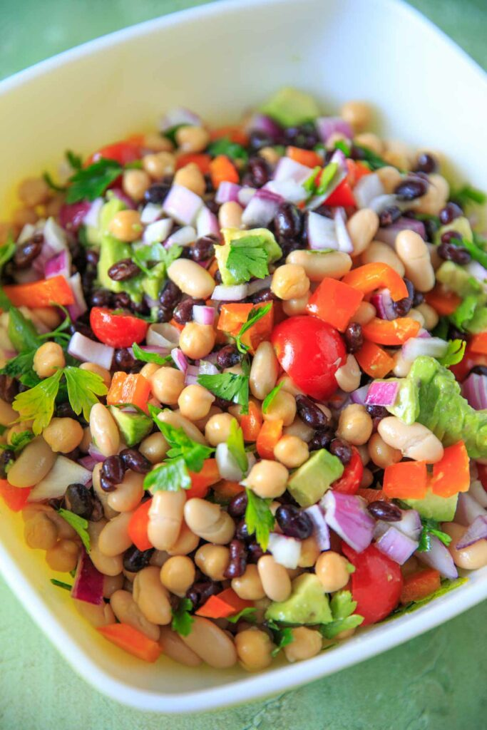 Three Bean Salad with avocado, vegetables and herbs close up
