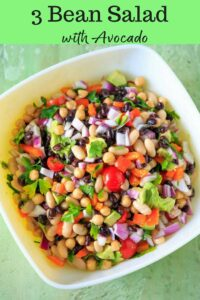 Three Bean Salad with avocado, vegetables and herbs. A flavorful vegan and gluten-free side dish perfect for a picnic or potluck, and filling enough for a meal!