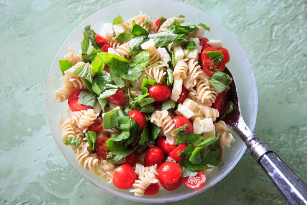 Caprese Pasta Salad - Tomatoes, basil, mozzarella, olive oil and pasta
