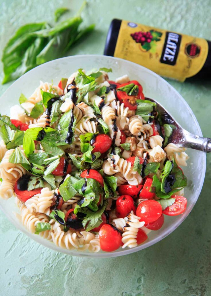 Caprese Pasta Salad - Tomatoes, basil, mozzarella, balsamic and olive oil on pasta