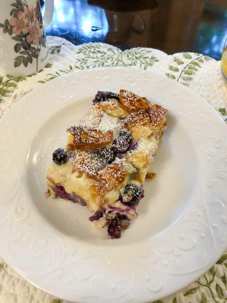 Blueberry Cheesecake French Toast is just as amazing as it sounds! It's made with croissants instead of bread and will be a hit at your brunch table.