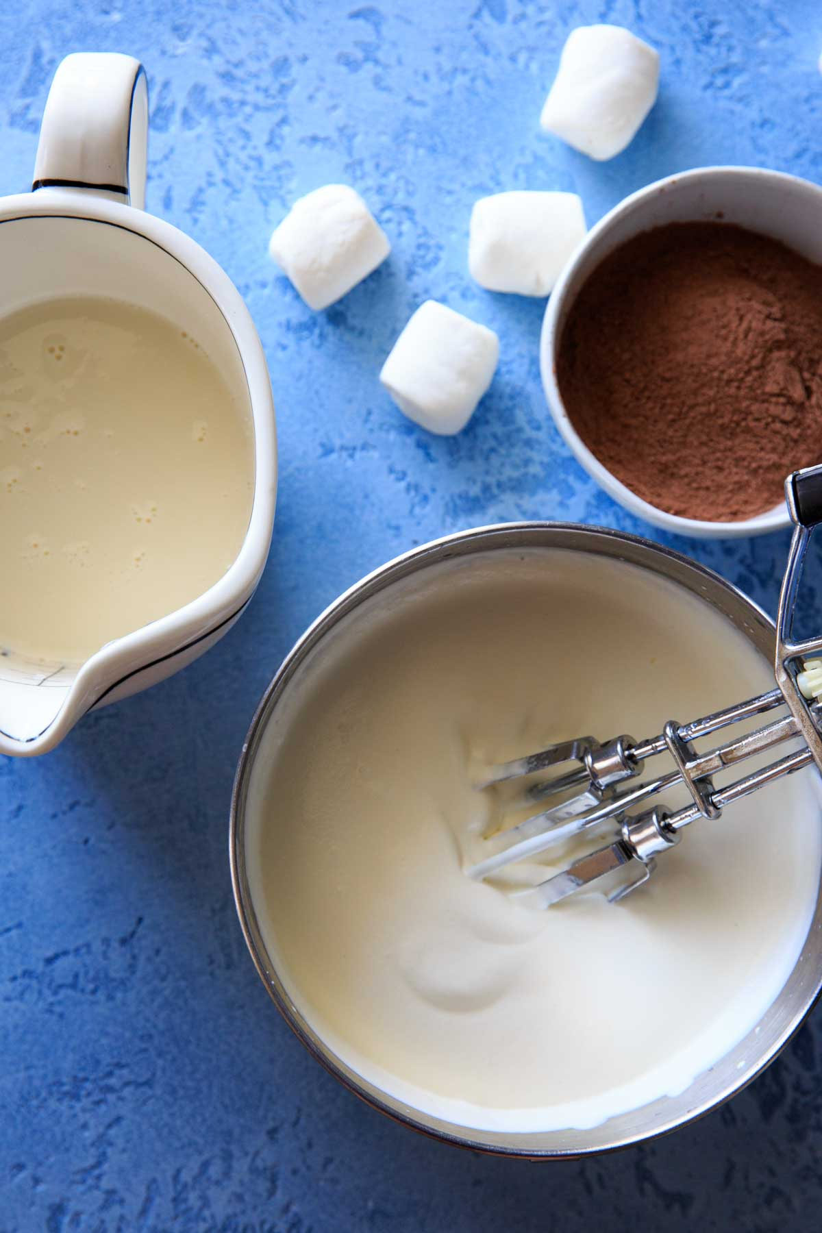 Hot Chocolate Ice Cream ingredients - homemade sweetened condensed milk, whipped whipping cream and hot chocolate mix