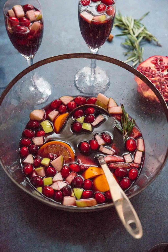 Holiday Sangria - a dry red wine winter sangria that's not too sweet, filled with fruit and is designed to make you feel cozy.