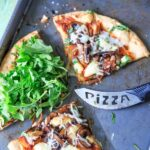 Upgrade your pizza night by making homemade pizza with caramelized onions, mushrooms, fresh baby arugula and brie cheese! You'll love this vegetarian pizza because it's so flavorful, fresh and unique. A little bit of sweet along with a little bit of peppery flavors!