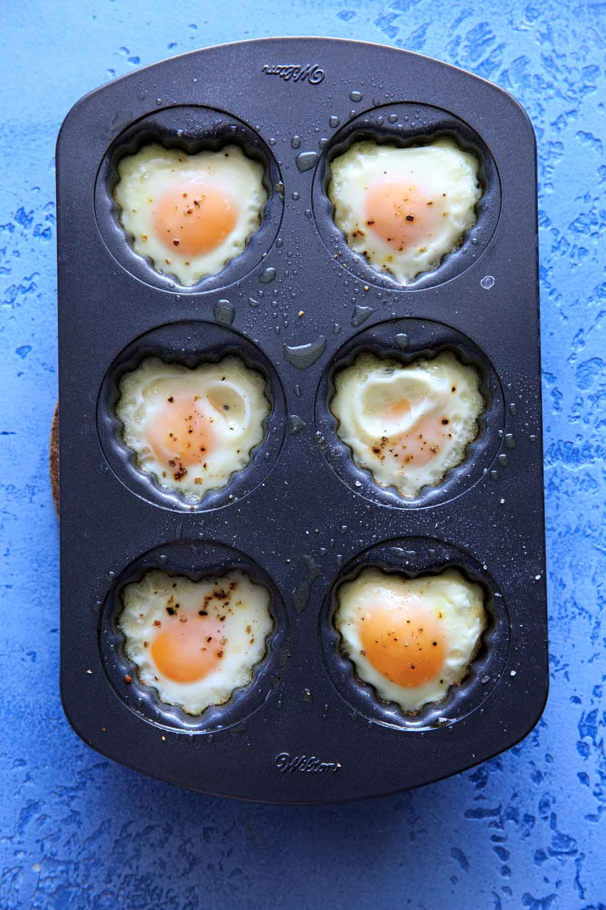 heart shaped egg breakfast cups in a heart muffin pan