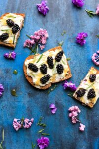 Blackberry Ricotta Toast with honey drizzle. Makes for a great breakfast, midday snack, or even a fruit berry dessert!