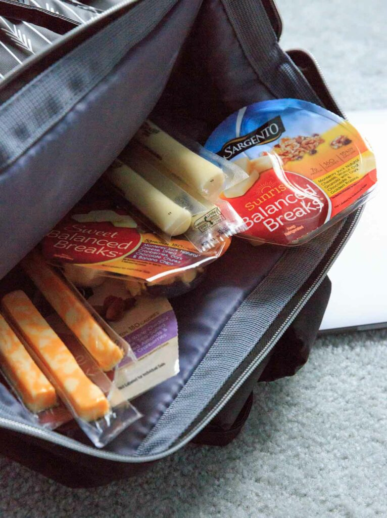 Packing Sargento cheese sticks and snacks in back pack