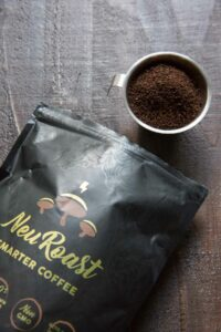 Neuroast coffee ground poured into cup with bag