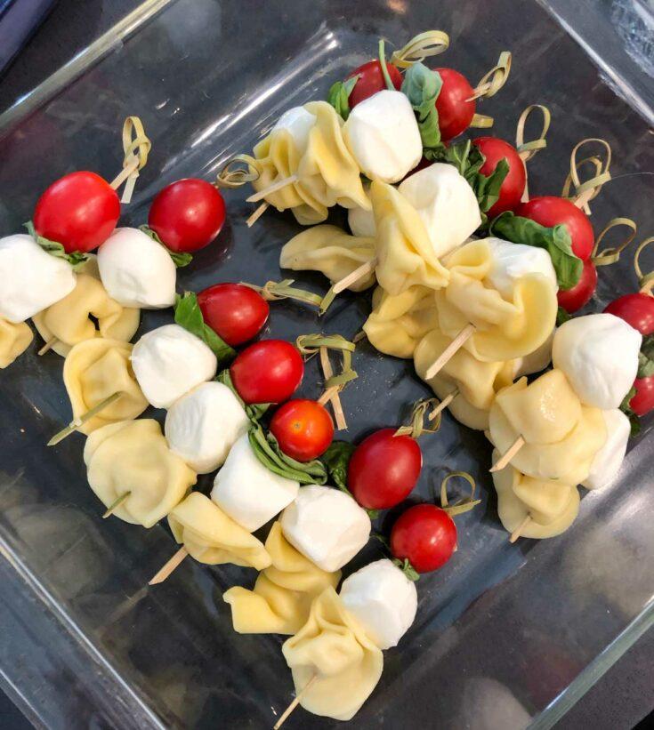 prepping caprese pasta salad skewers