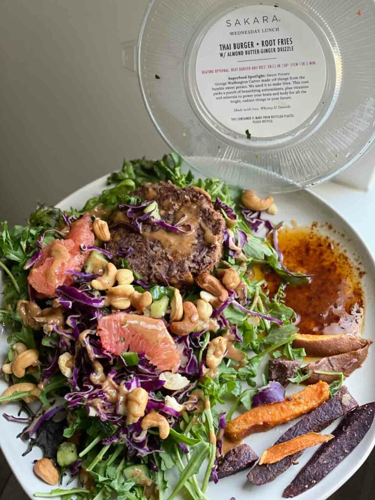 sakara thai burger and root fries with almond butter-ginger drizzle