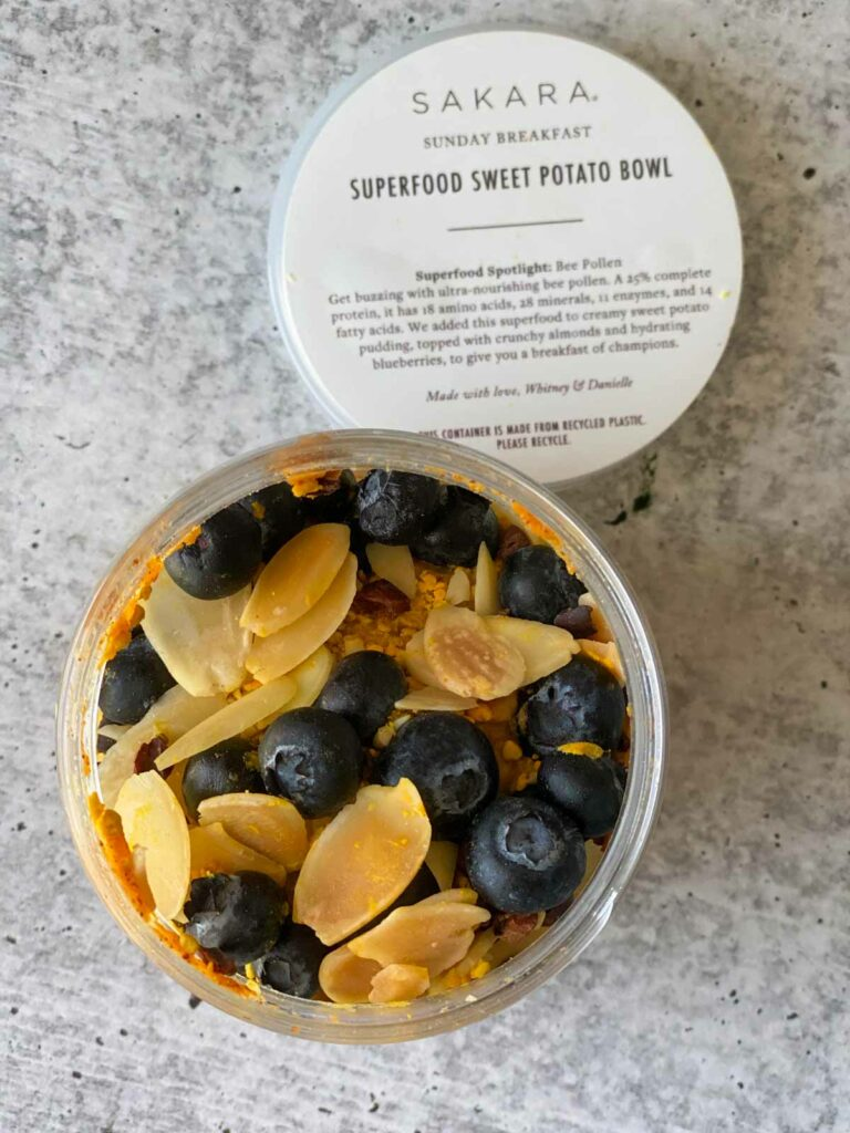 superfood sweet potato bowl breakfast with blueberries and bee pollen