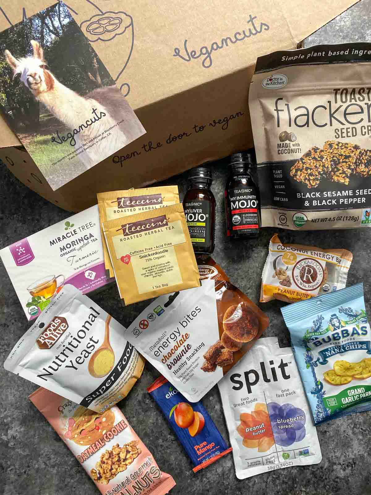 Vegancuts snack box preview and animal sanctuary postcard