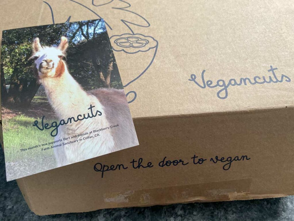 Vegancuts box and animal sanctuary donation postcard