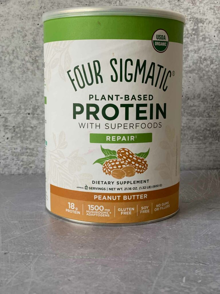 four sigmatic peanut butter protein canister