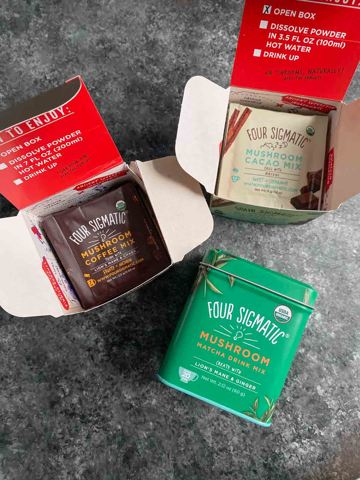 Four Sigmatic coffee and cacao packets with matcha