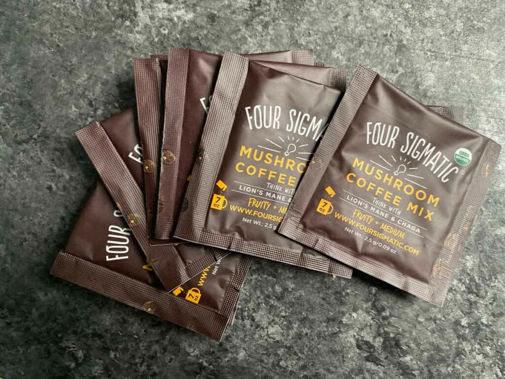 Four Sigmatic coffee packets instant