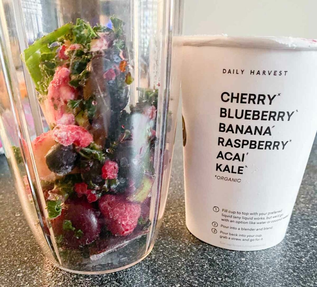 Cherry acai smoothie from daily harvest in blender before blending