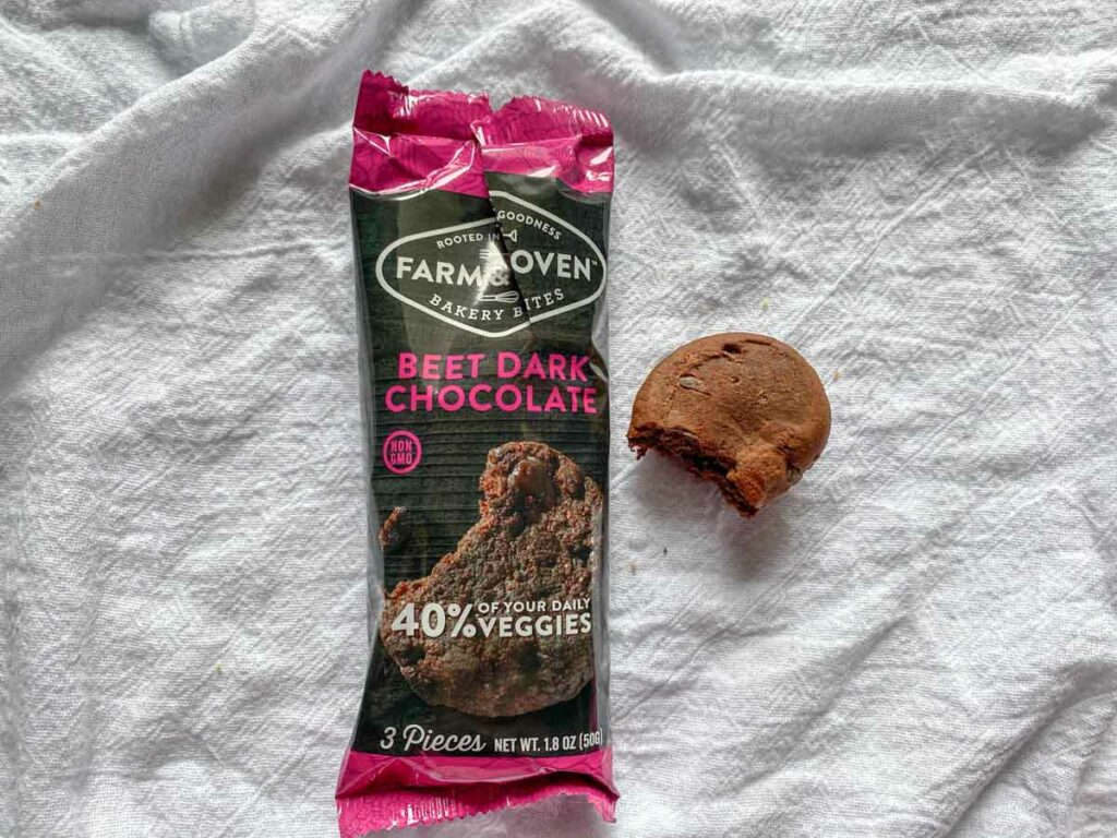 Beet dark chocolate flavor from Farm & oven with a bite out of one muffin