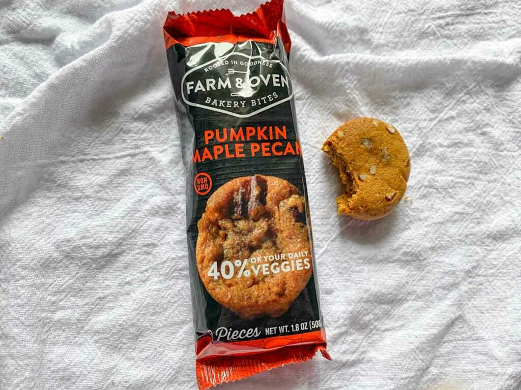 Pumpkin maple pecan flavor from Farm & oven with a bite out of one muffin
