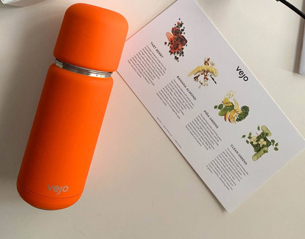 Vejo orange portable blender and starter pack flavor info card