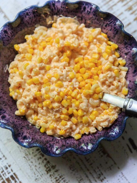 macaroni and cheese with corn in serving bowl