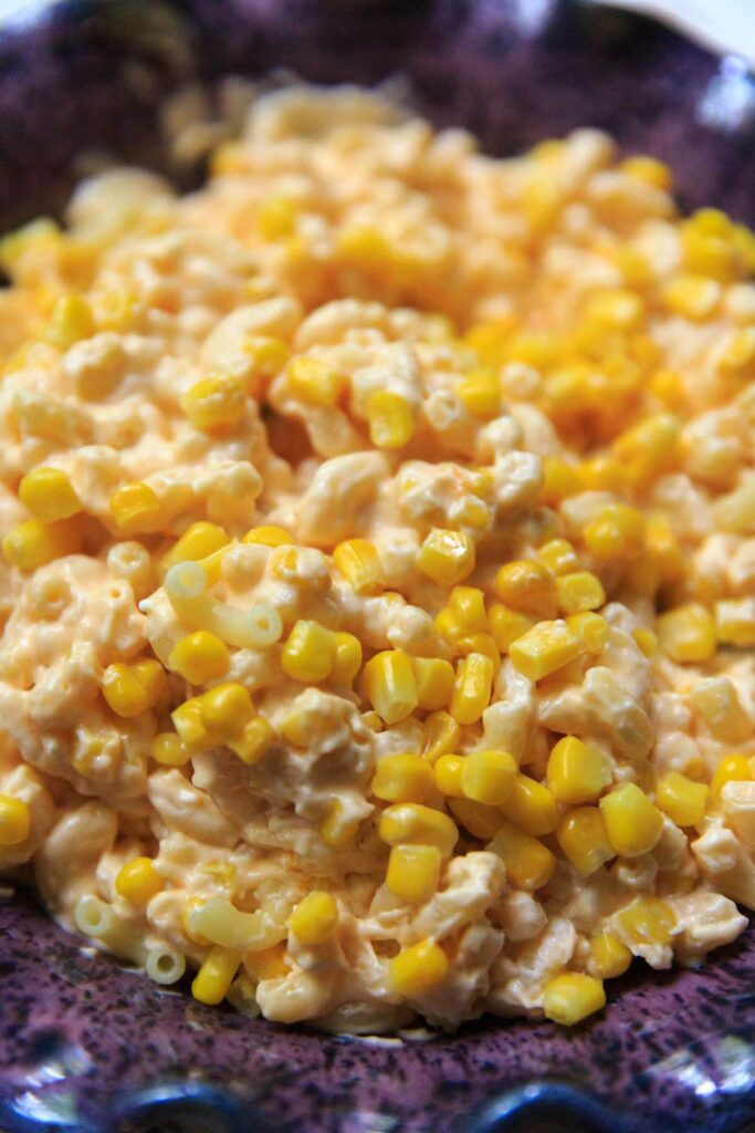 close up of macaroni and cheese with corn