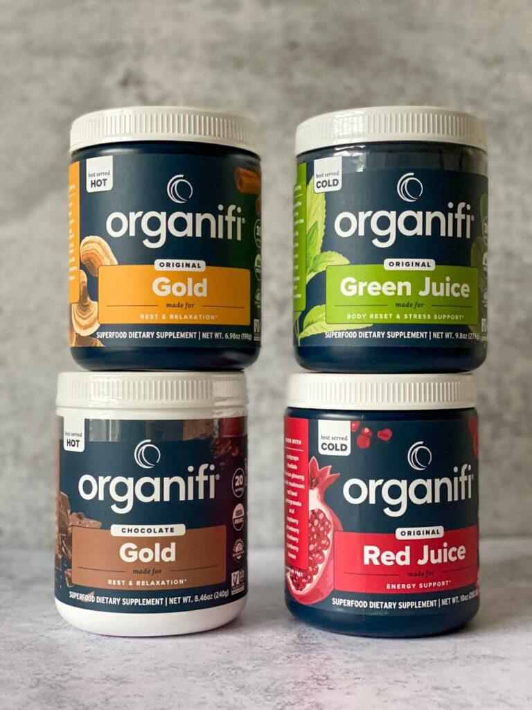 4 tubs of organifi - gold juice powder, green juice powder, chocolate gold powder, red juice powder