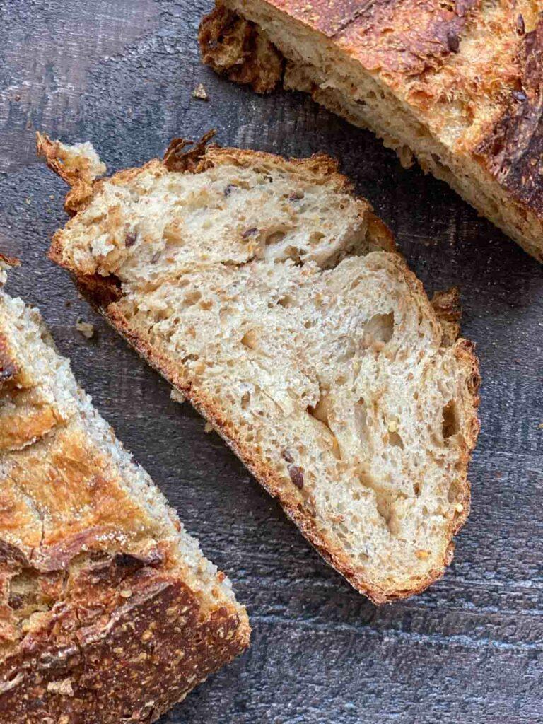 a slice of Wildgrain 7-grain sourdough bread