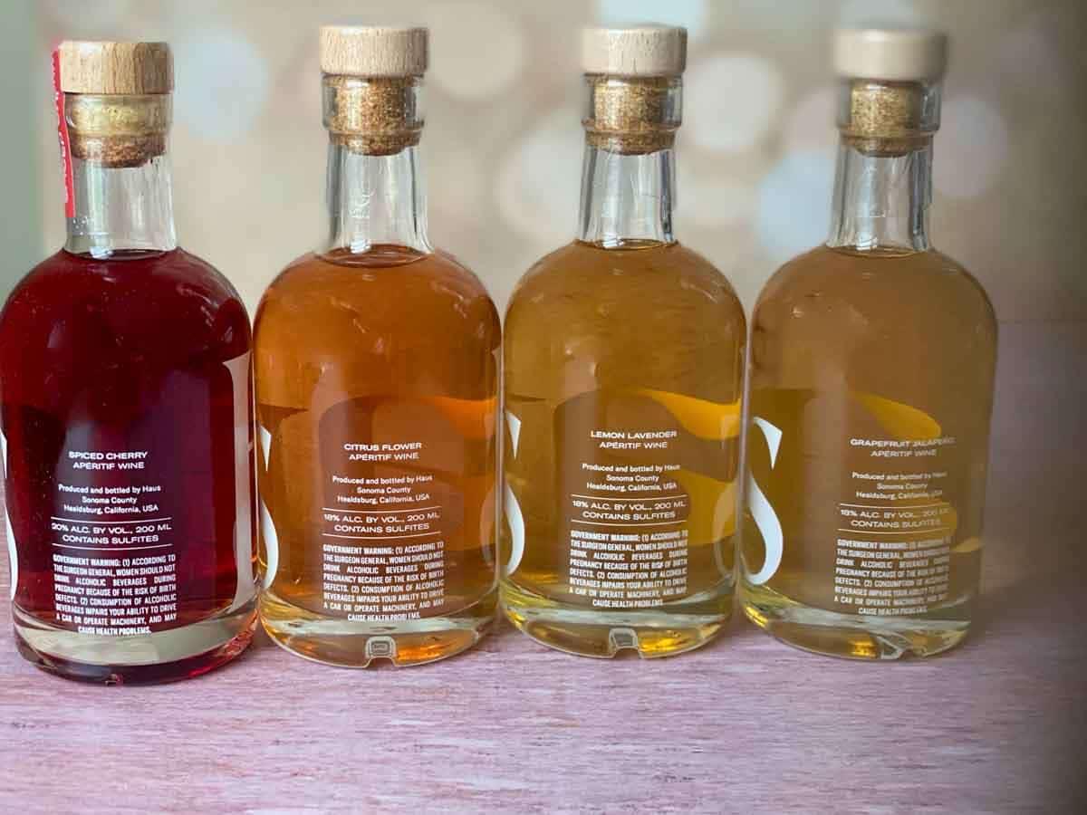 back of 4 bottles haus sampler kit