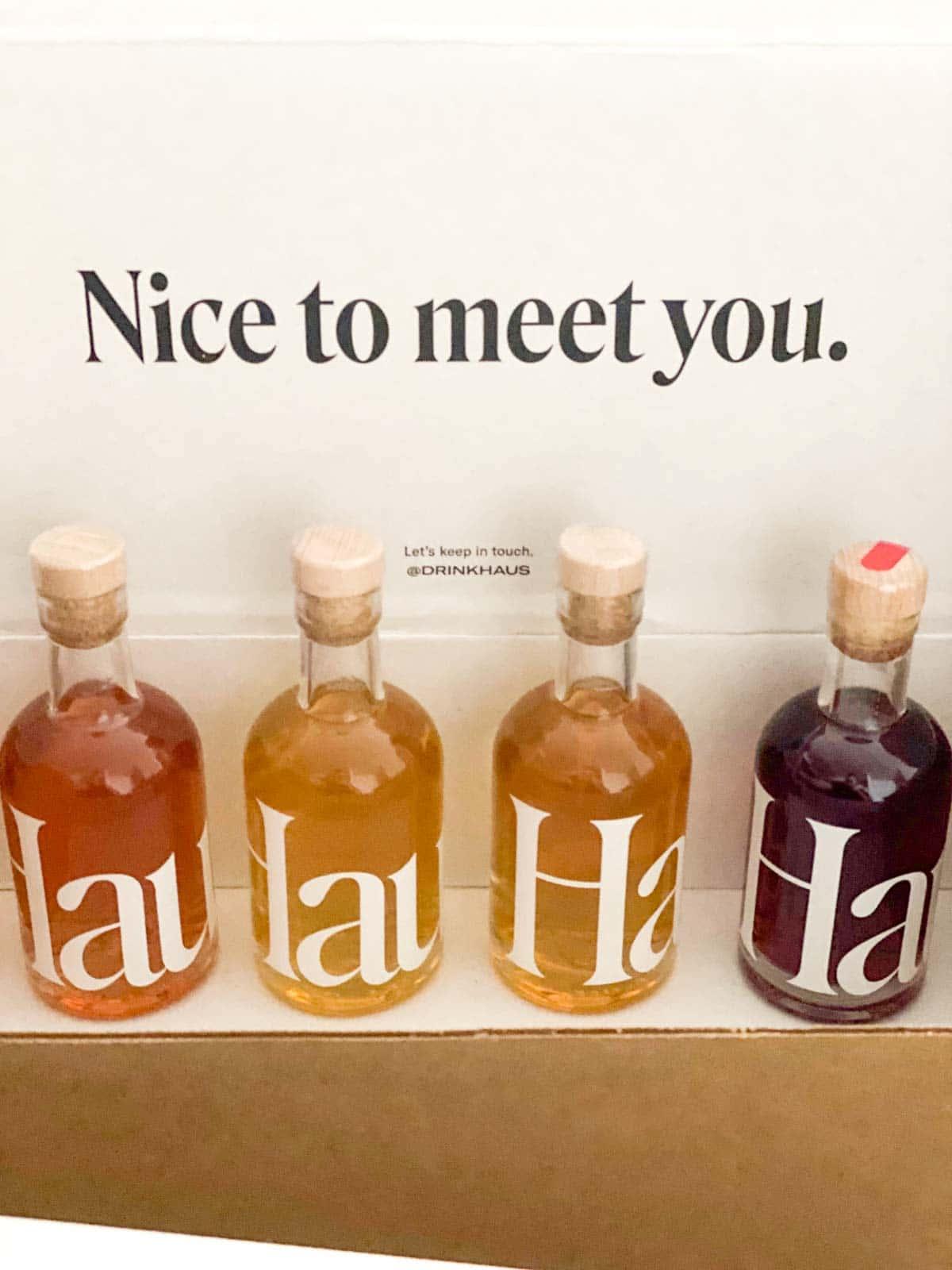 """haus sampler kit 4 bottles, with """"nice to meet you"""" on box"""