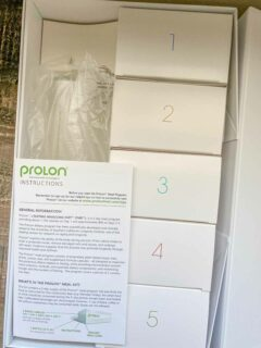 Prolon instructions with 5 small boxes of food, one for each day of the fasting mimicking diet