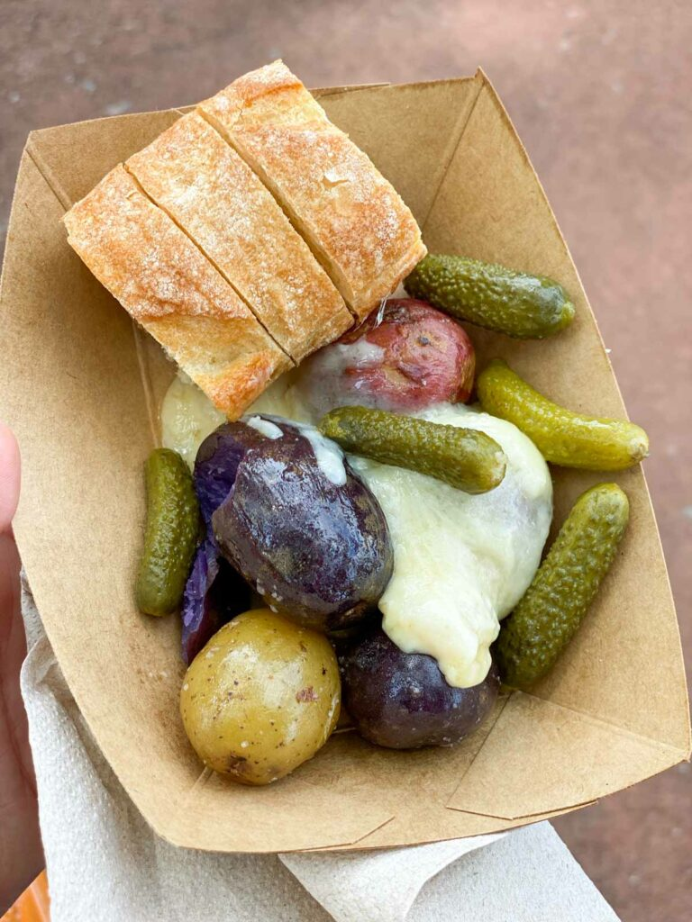 Epcot the Alps Warm Raclette Swiss Cheese with Baby Potatoes, Cornichons (pickles) and Baguette