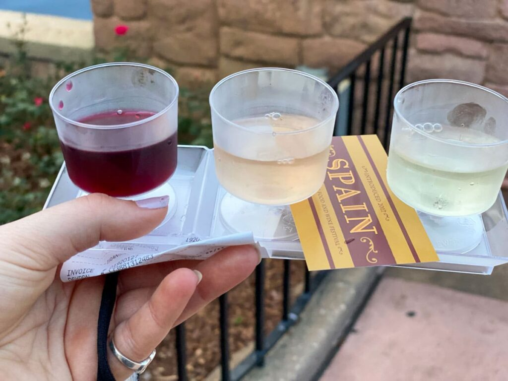Epcot food and wine festival spain wine flight, one red one rose and one white wine