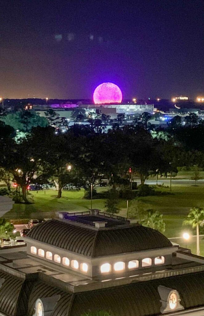 nighttime view of the epcot ball from the skyliner